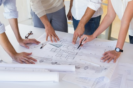 Casual architecture team working together at desk